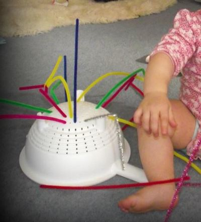 colander baby motor skills hand eye fun play