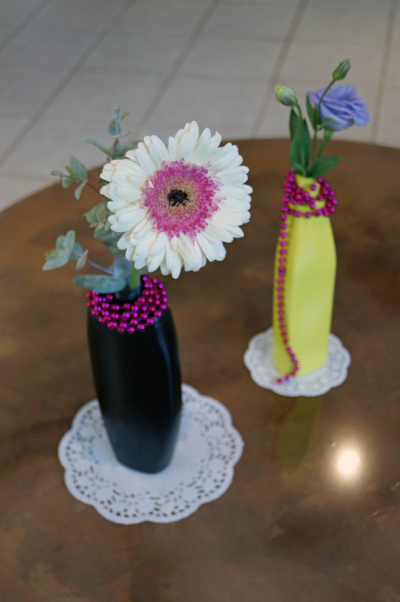 Decorating vases upcycle plastic bottles into vases for Plastic bottle decoration