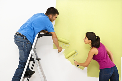 man woman couple young love painting decorating paint decor home clean fresh design roller fun