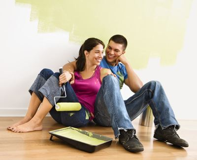 man woman couple young love painting decorating paint decor home sell moving clean fresh