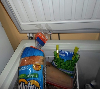 Using pegs to seal frozen packets