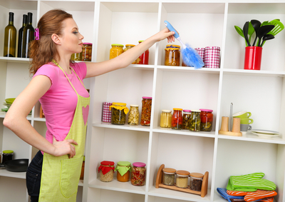 woman housewife mum mother dusting housework chores kitchen cooking apron feather duster proud clean personal shelves wine food preserves homemade